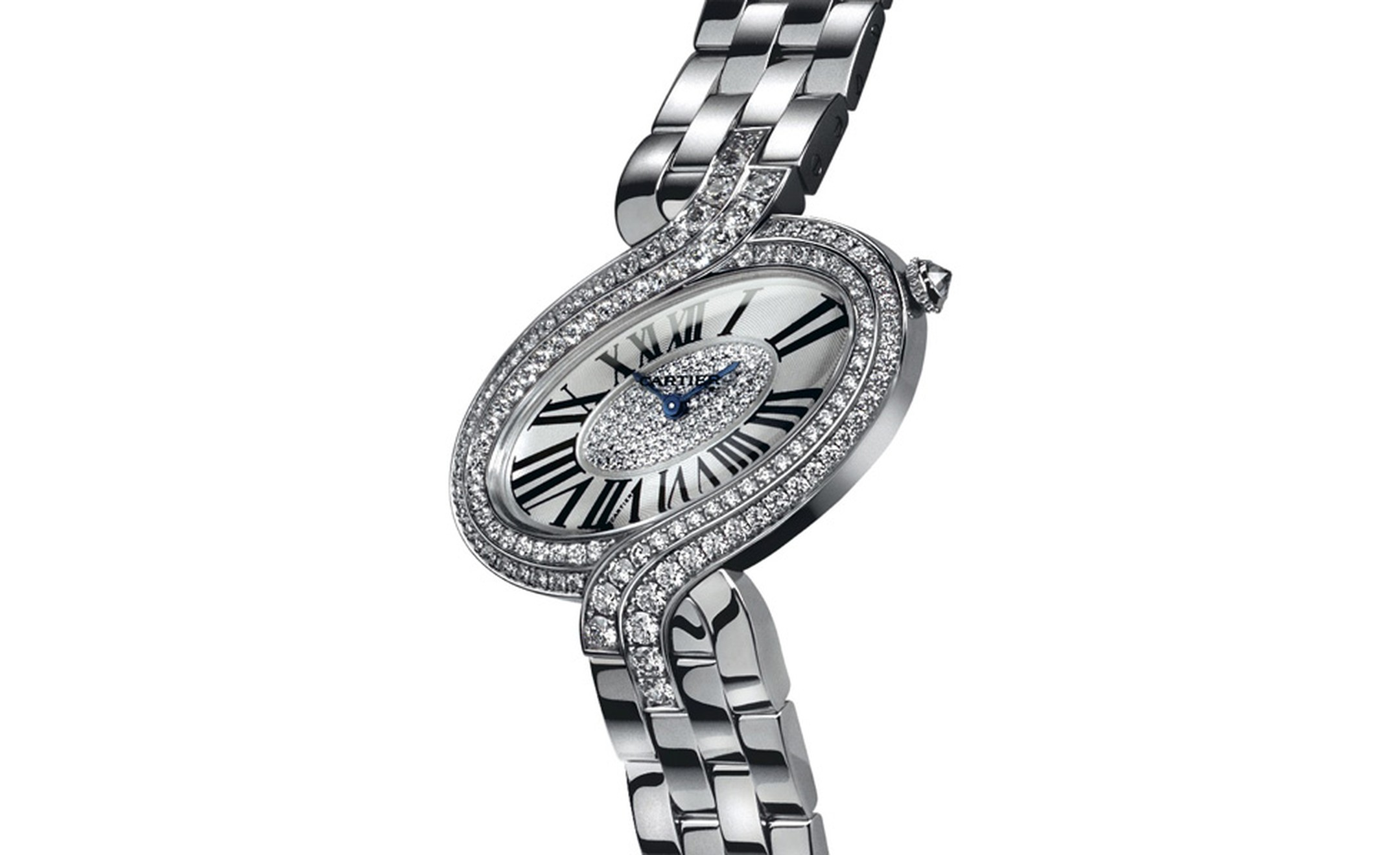 Délices de Cartier in white gold with diamonds. The twists of the case resemble a ribbon. Photo: Studio Dielemen Cartier 2010