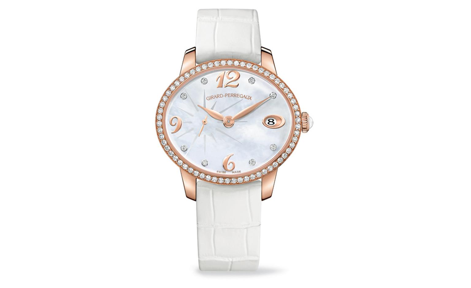 Girard-Perregaux Cat's Eye automatic watch in rose gold with mother of pearl dial.