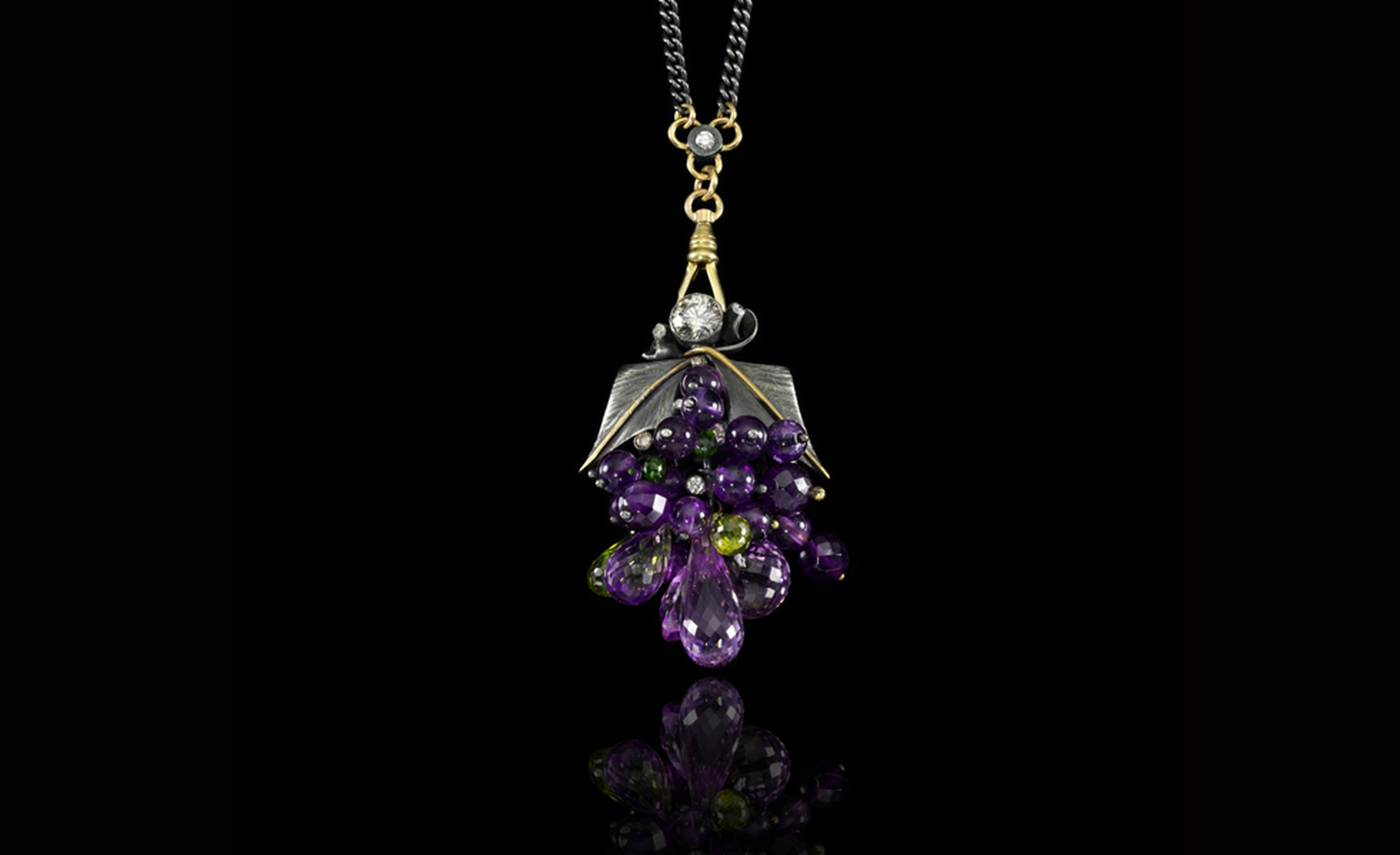 Jessica McCormack, 'Gluttony' gem-set, diamond, 18k yellow gold and silver pendent necklace, from the XIV collection. Designed as a cluster of facetted amethyst, period and chrome diopside, highlighted by brilliant-cut diamonds,   engraved silve...