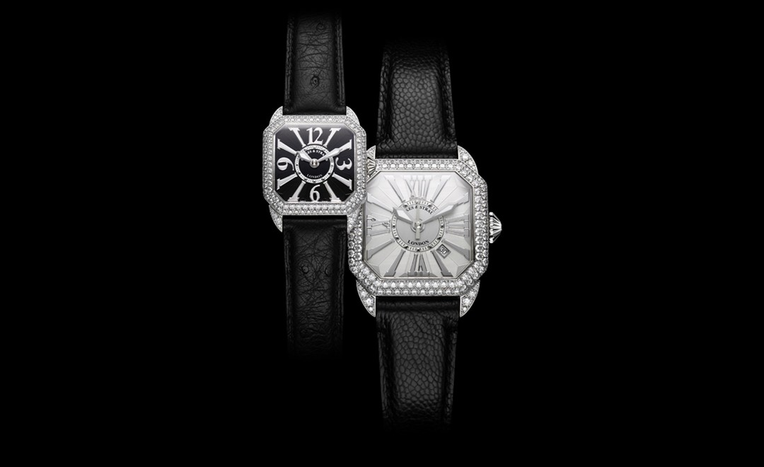 Backes & Strauss, two Berkeley watches in white gold. The black dial model boasts 129 diamonds weighing 1.77 cts. Price £16,130. The larger white dial model has 139 diamonds weighing in at 3.44 carats. Price: £39,005