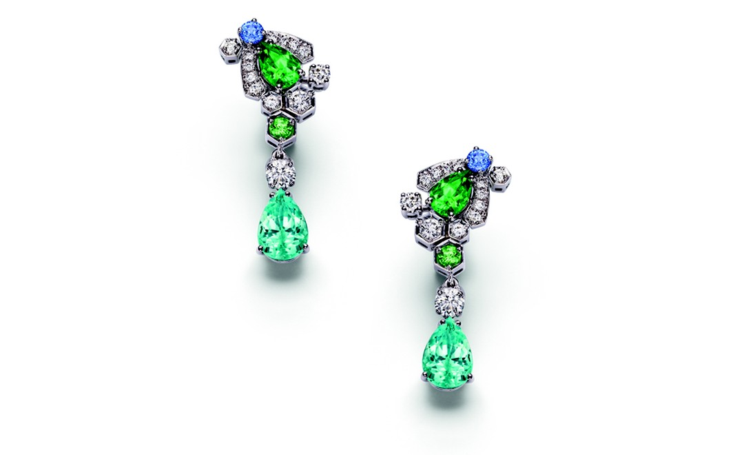 Chaumet Bee My Love earrings with diamonds, sapphires, tsavorite garnets and bright blue tourmalines. Note the honeycomb shapes around the little bee.