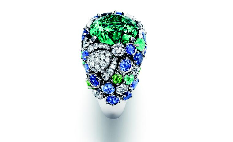 Chaumet Bee My Love ring with a diamond set bee crawling over luscious green tsavorites, tourmalines and sapphires with a blue-green tourmaline at the centre.