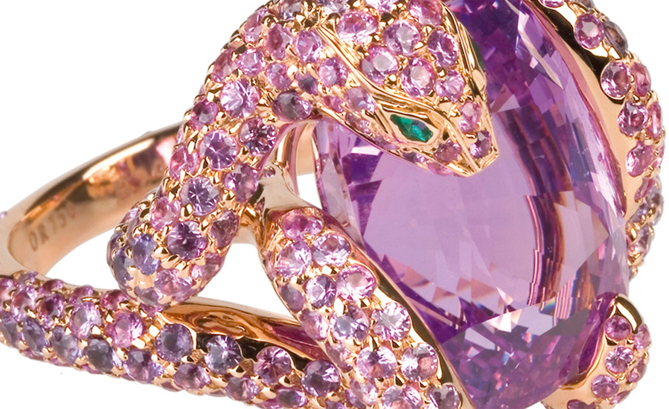 Detail of the Boucheron Python ring with a Ceylon pink 17.36 carats cushion cut sapphire and 330 pink and 51 purple sapphires set into rose gold. Price: £244,000