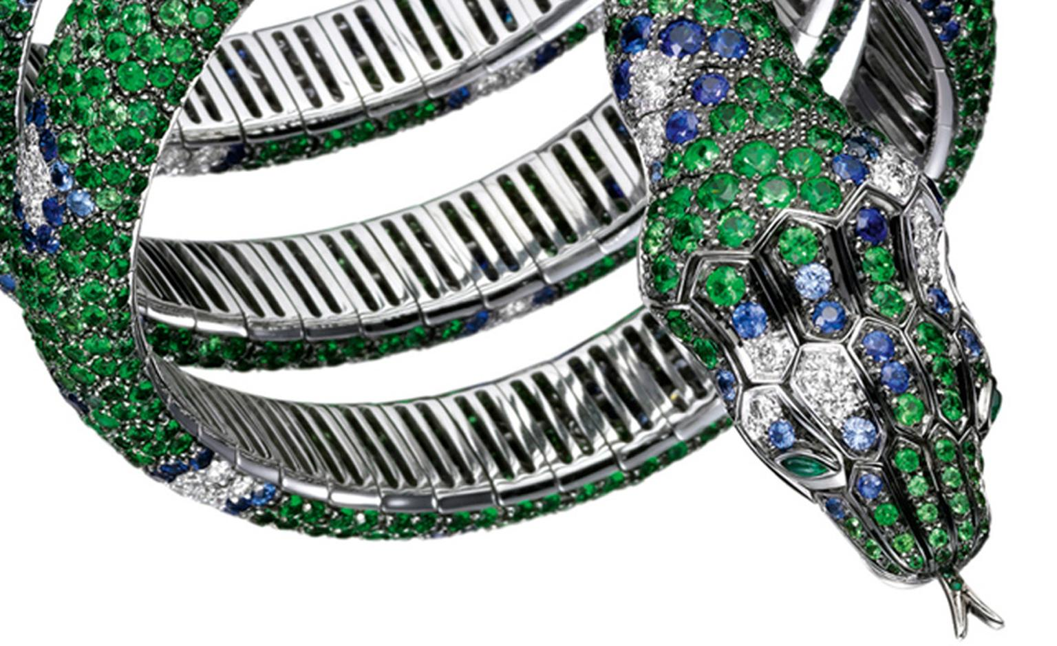 Detail of the Boucheron Python Bracelet with 700 tsavorites, 440 sapphires and 120 diamonds in white gold. Price: £166,000