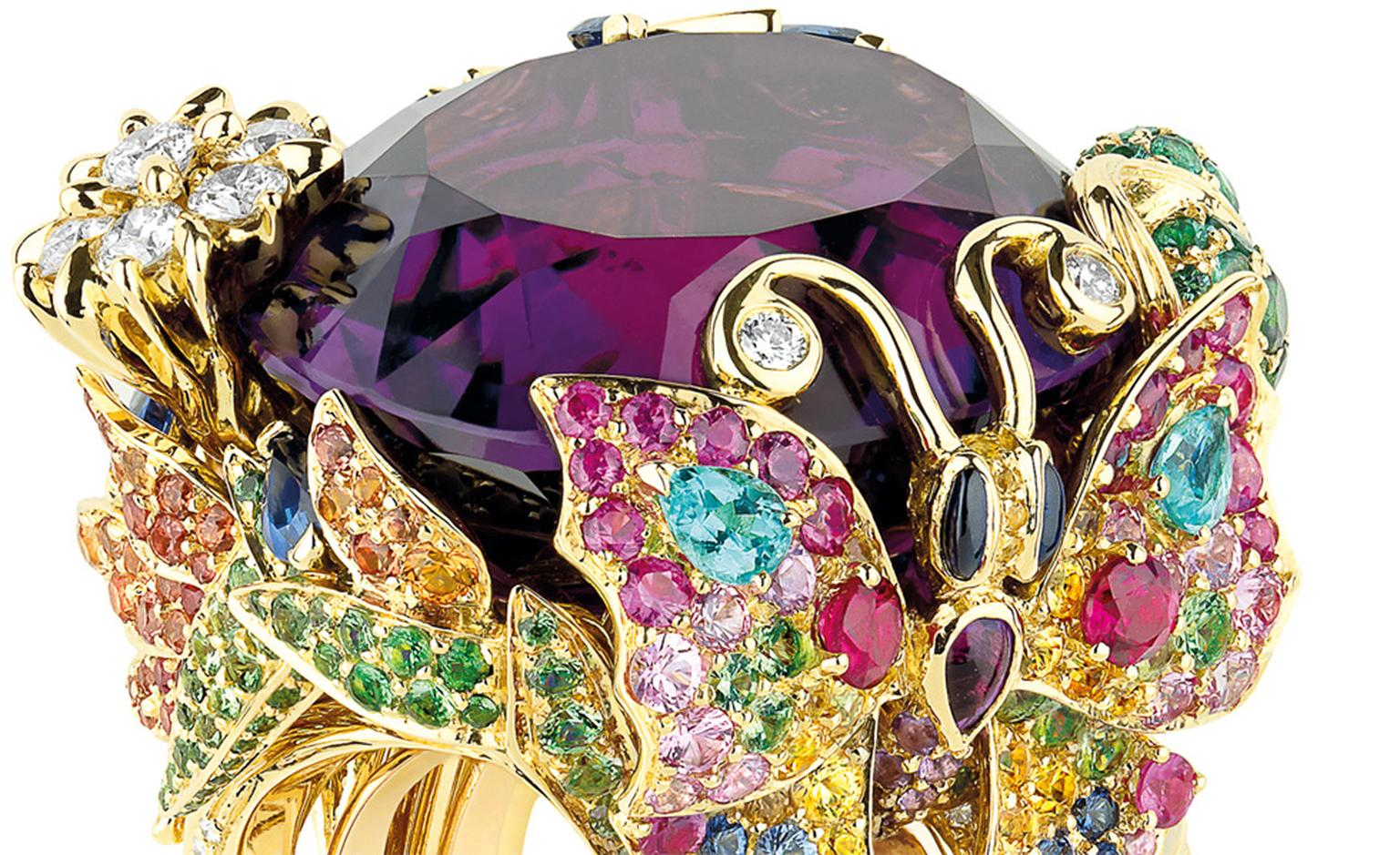 Close up of the Dior 'Incroyables et Merveilleuses' Papillon de Paradis ring. Look at the butterfly on resplendant in sapphires, pink, orange and yellow sapphires and the flash of swimming-pool blue Paraiba tourmalines