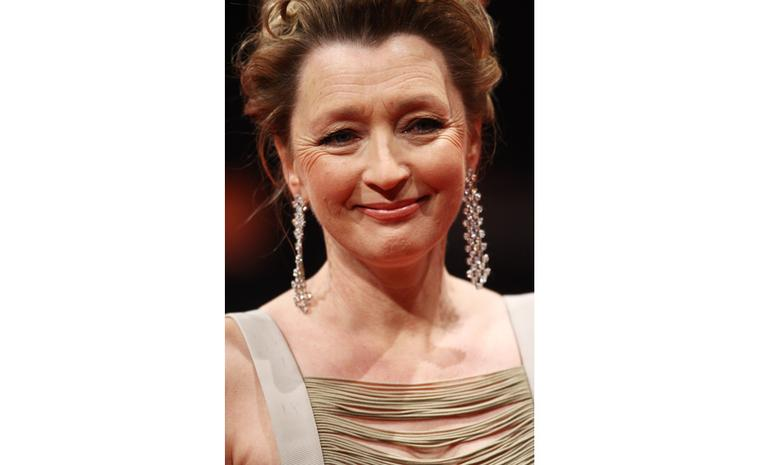 Close-up of Lesley Manville at 2011 BAFTAS wearing Chopard diamond earrings and watch