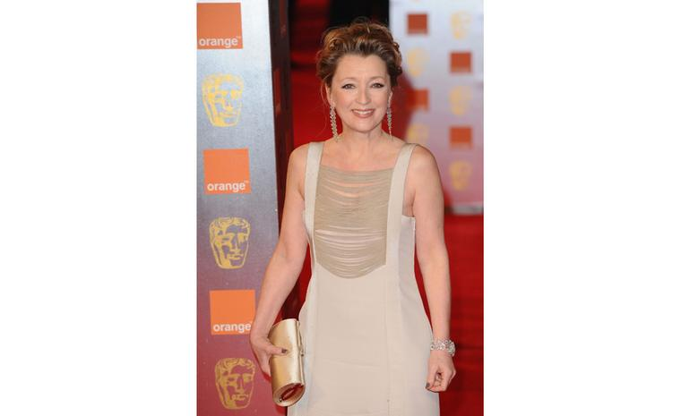 Lesley Manville at 2011 BAFTAS wearing Chopard diamond earrings and watch