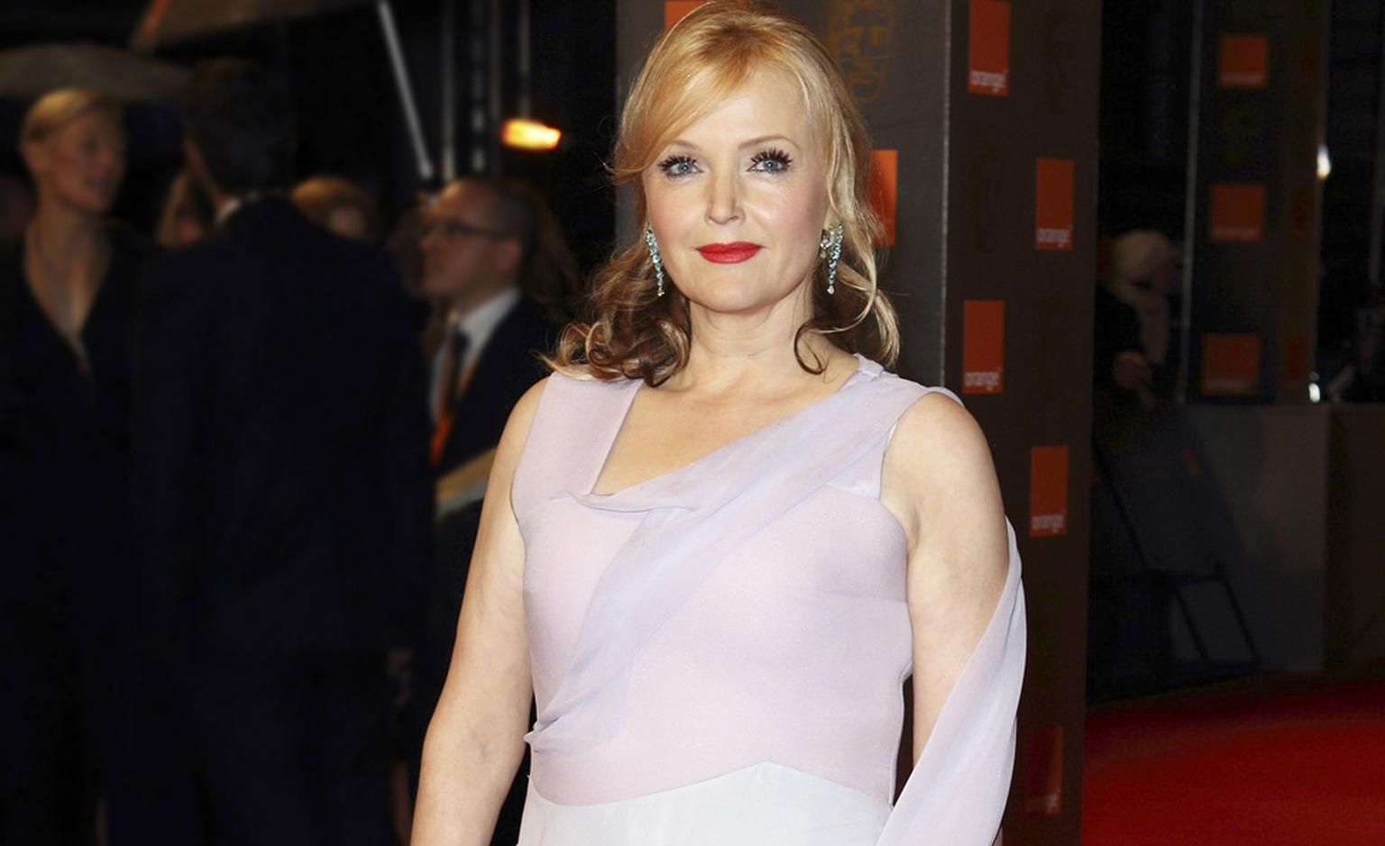 Miranda Richardson wearing Van Cleef & Arpels earrings and bracelet to BAFTAS 2011 Photo by Mike Marsland GettyImages