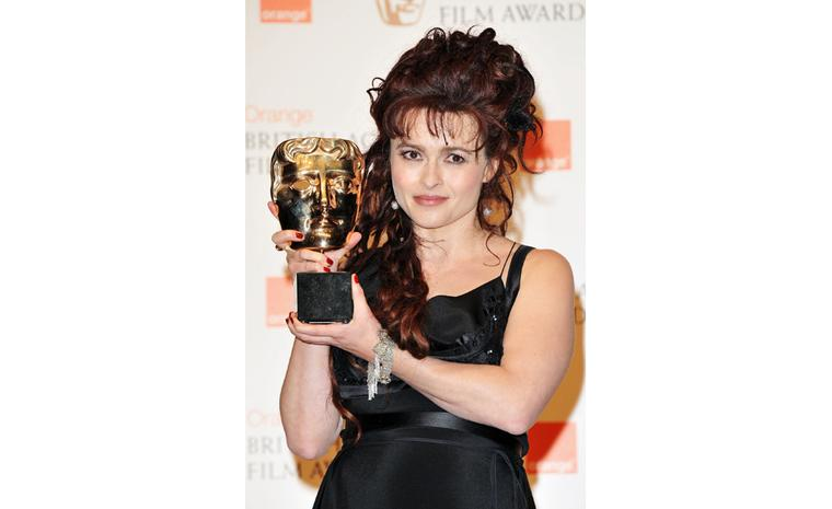Helena Bonham Carter collects her BAFTA award wearing Solange Azagury-Partridge bracelet and earrings