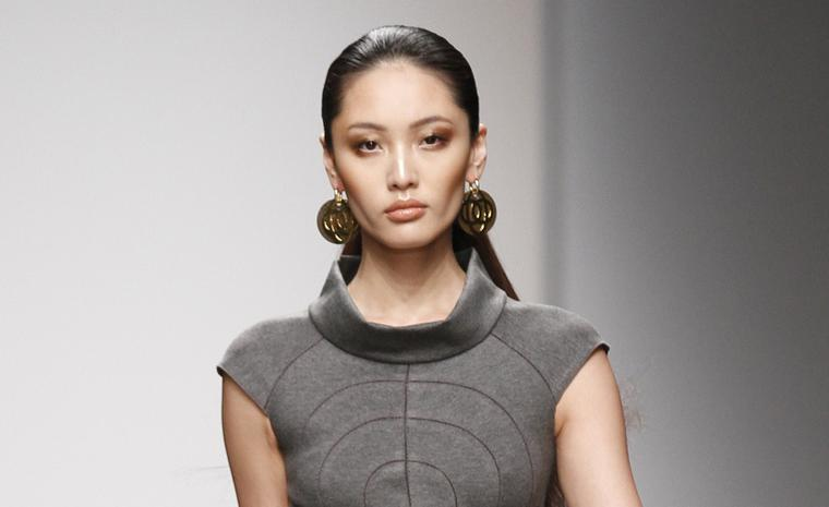 Model wearing Noor earrings at Issa catwalk show London Fashion Week Feb. 2011. The stark lines of the Noor earrings complement the minimalist tailoring of the Issa dress.