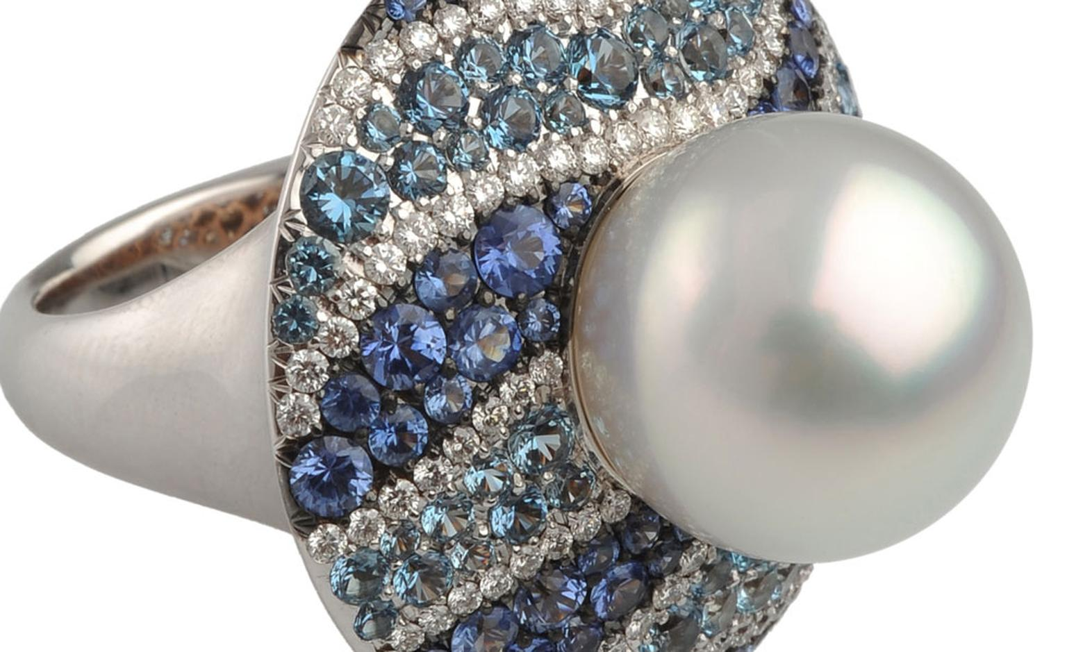 Close up of the Autore, Fire & Ice Iceberg white gold, South Sea pearl, diamond, blue sapphire and aquamarine ring. I love the waves of different shades of blue that ripple alongside the lustre of the pearl. $25,500 AUD