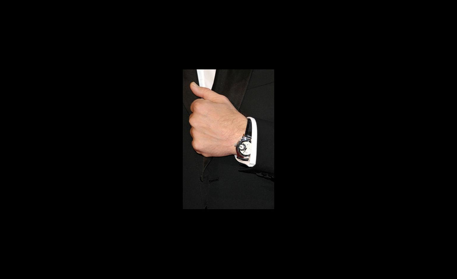 Javier Bardem wears a Chopard L.U.C. Regulateur watch to the Oscars 2011