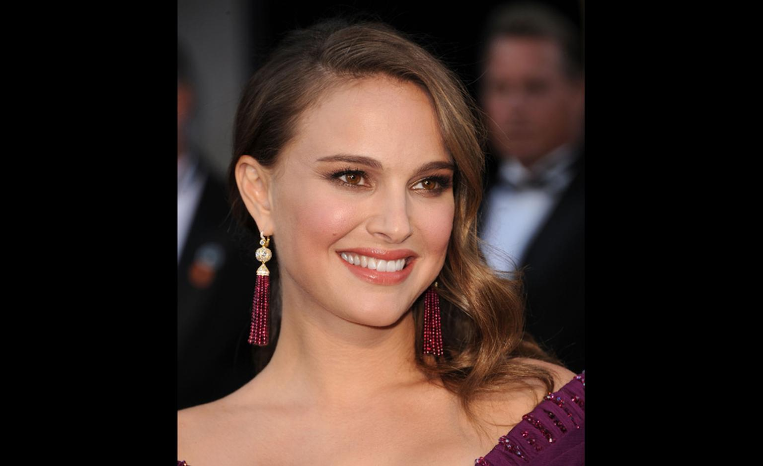 Natalie Portman, who won 'Best Actress' Oscar at the Academy awards for her role in Black Swan wears Tiffany rubellite tassel earrings on the red carpet.