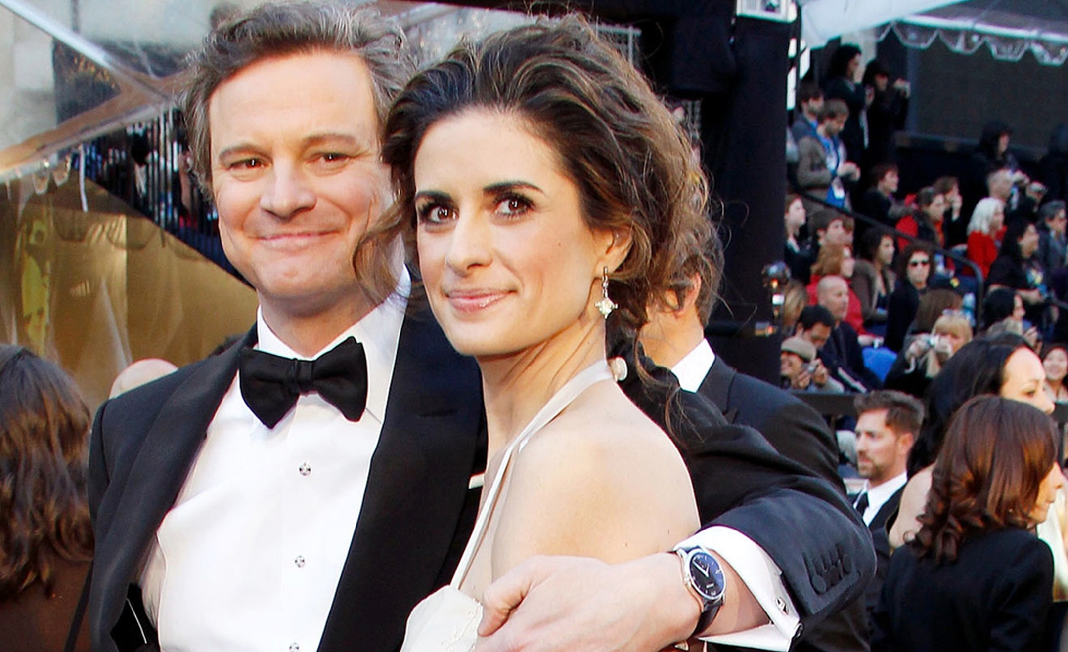 A proud Colin Firth embraces his wife Livia Giuggioli showing to advantage his Chopard L.U.C. XPS white gold watch