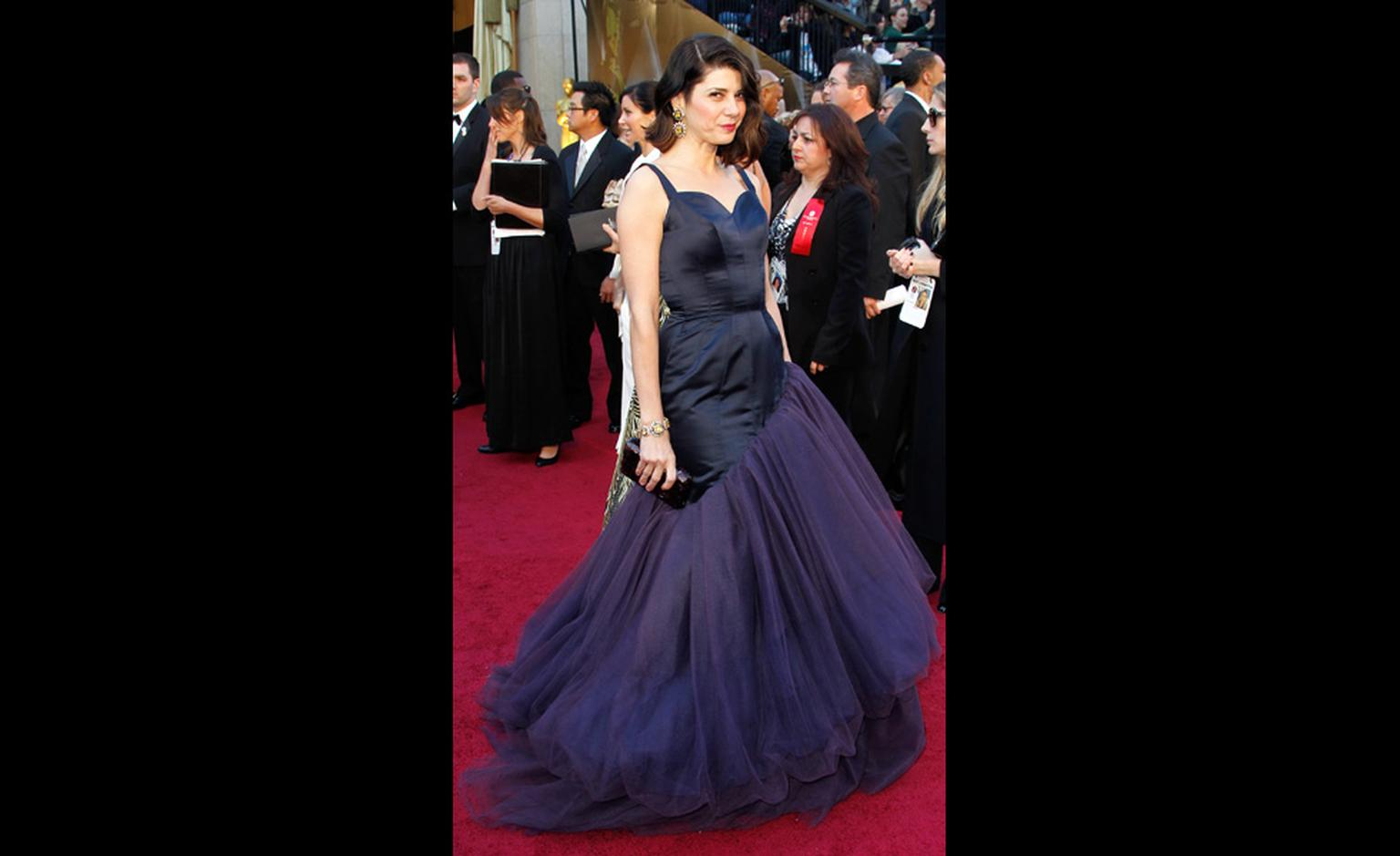 Marisa Tomei in her spectacular Charles James gown set off by 1960 yellow and blue sapphire, emerald and diamond earrings and bracelet made for a private client by Van Cleef & Arpels, New York.