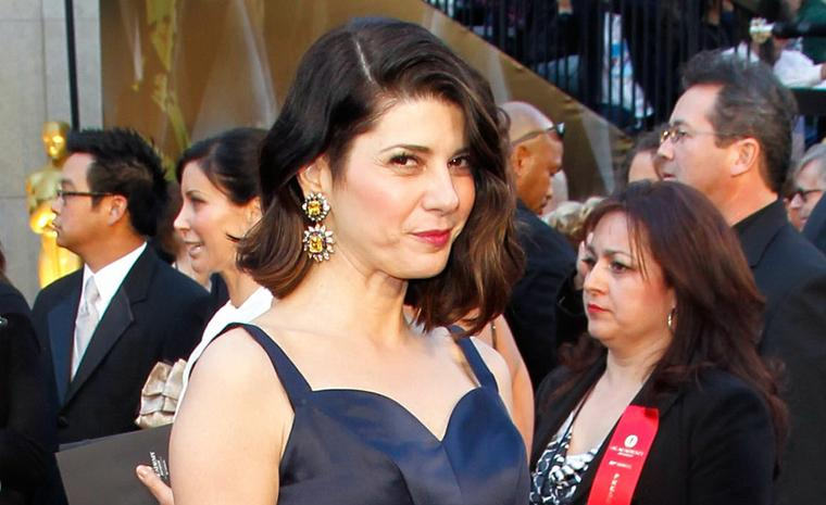 Marisa Tomei chose vintage Van Cleef & Arpels jewels. She wore 1960 yellow and blue sapphire, emerald and diamond earrings and bracelet made for a private client by Van Cleef & Arpels, New York