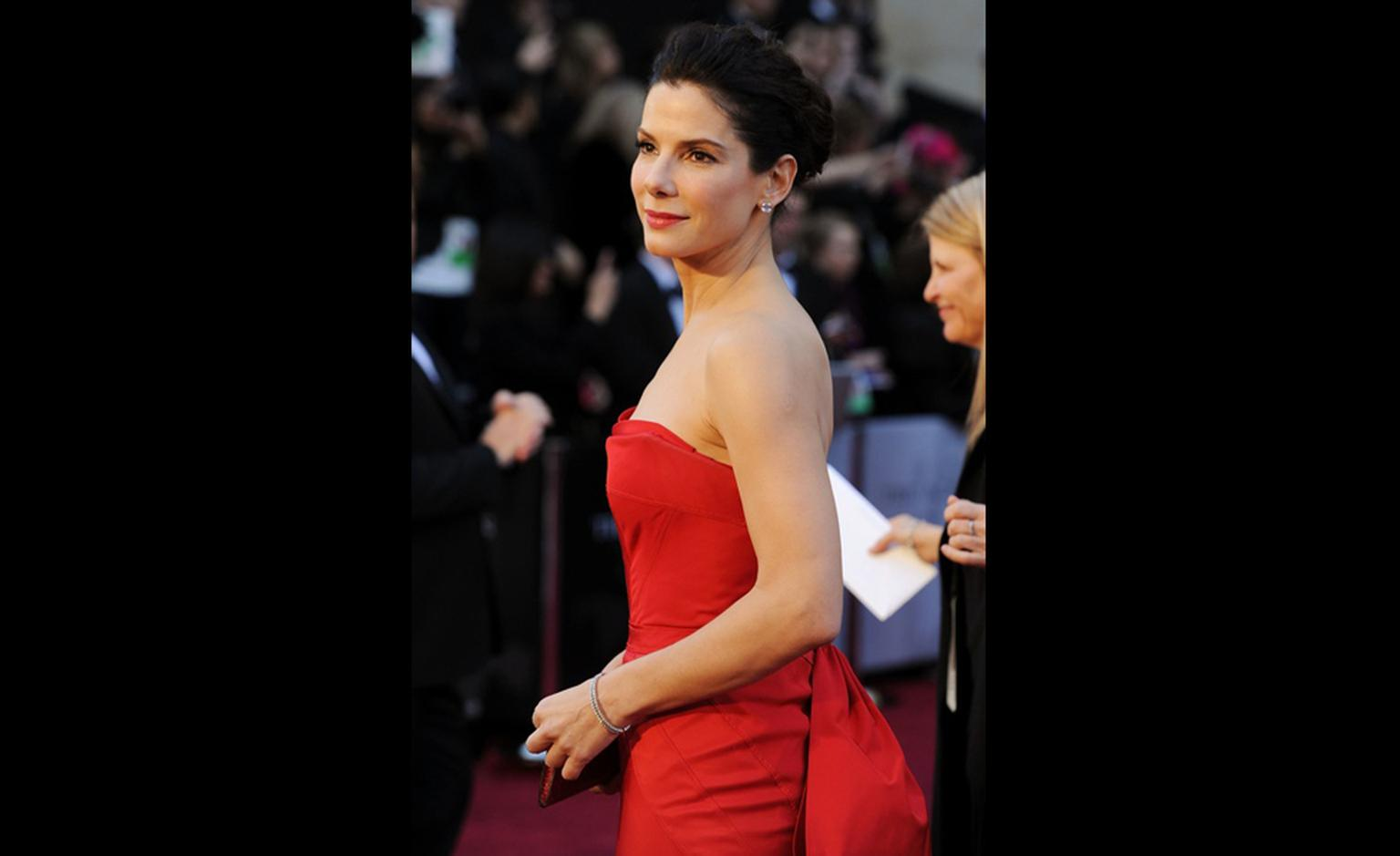 SANDRA BULLOCK wearing Harry Winston emerald Cut Diamond Earstuds, 5.5 carats each, Vintage Diamond Bead Bracelets