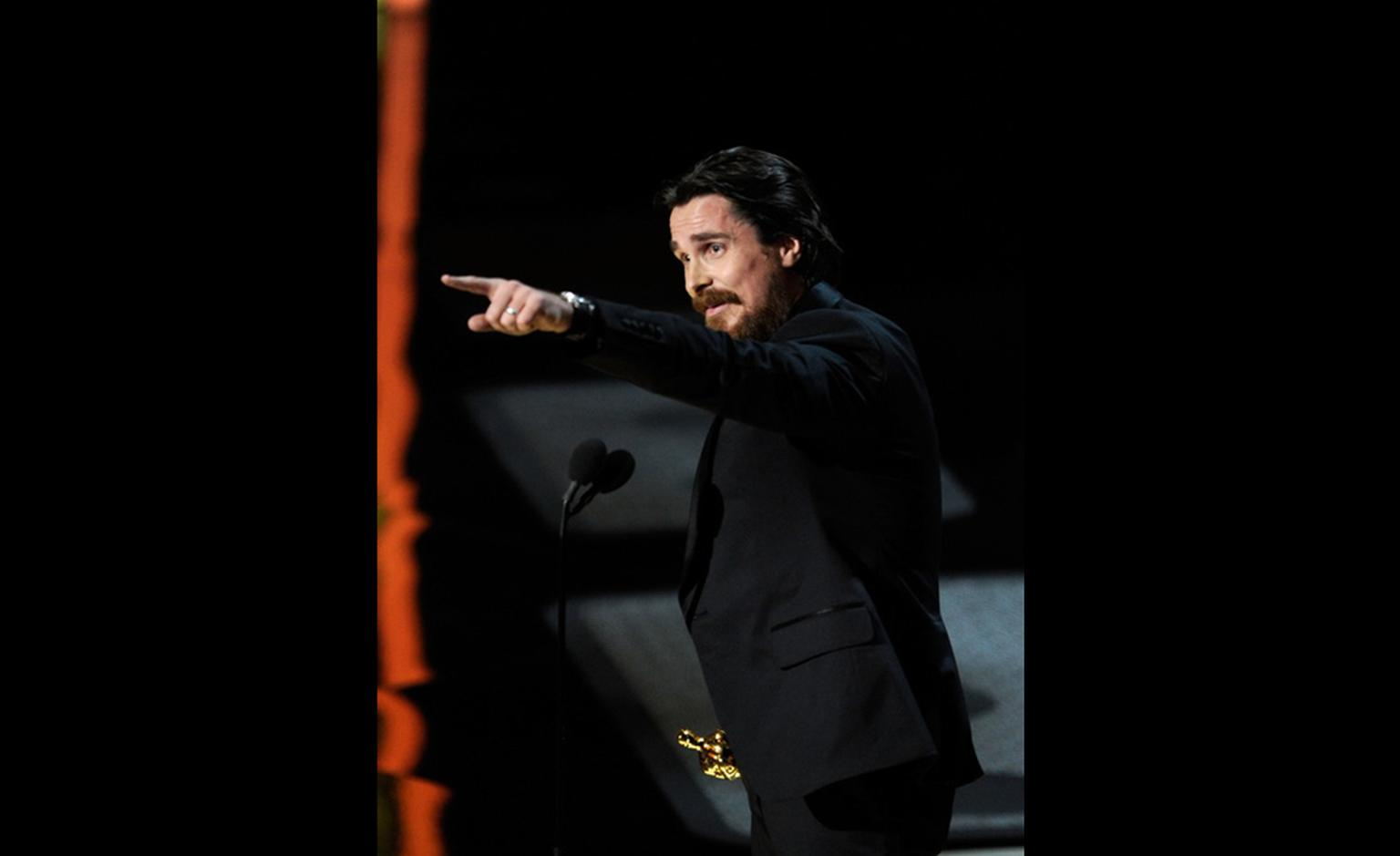 Christian Bale, winner of Best Actor in a Supporting Role wears Harry Winston Ocean Dual Time watch