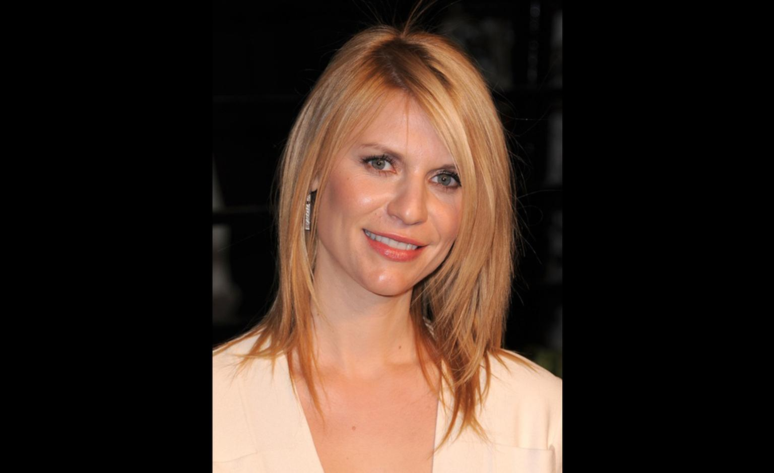 Claire Danes at the Vanity Fair Oscars Party wearing Traffic earrings by Harry Winston earrings