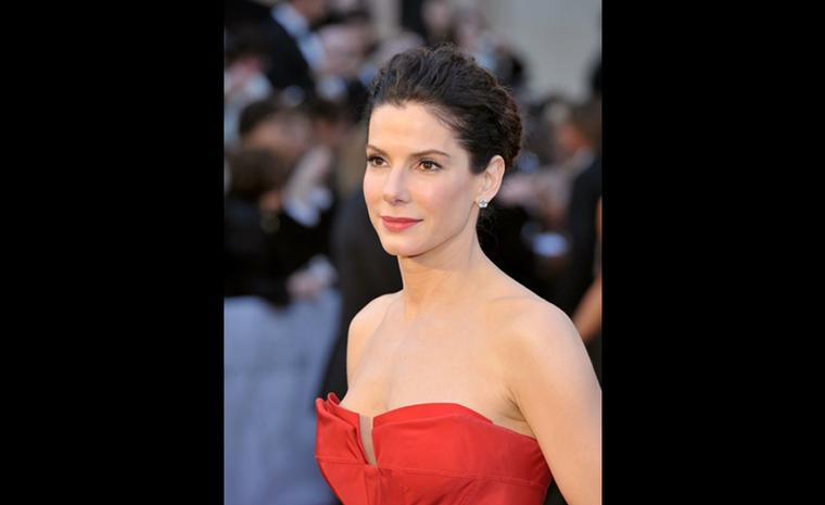 Sandra Bullock wearing Harry Winston emerald-cut diamond earstuds, 5.5 carats each