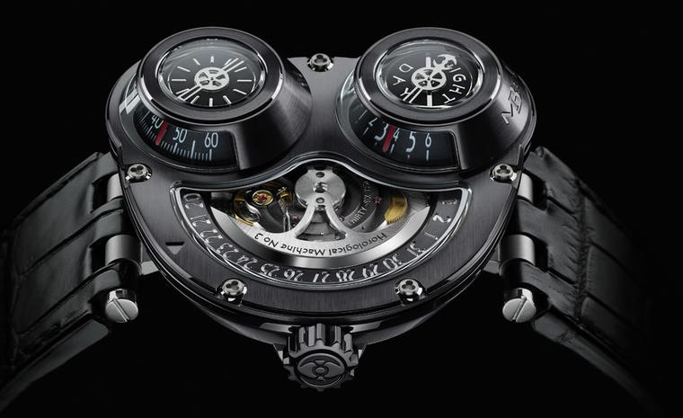 MB&F's ReBel is designed to be worn on the right wrist and the case is white gold with a black PVD coating. Time is read off the two cones under the bulging glass domes.