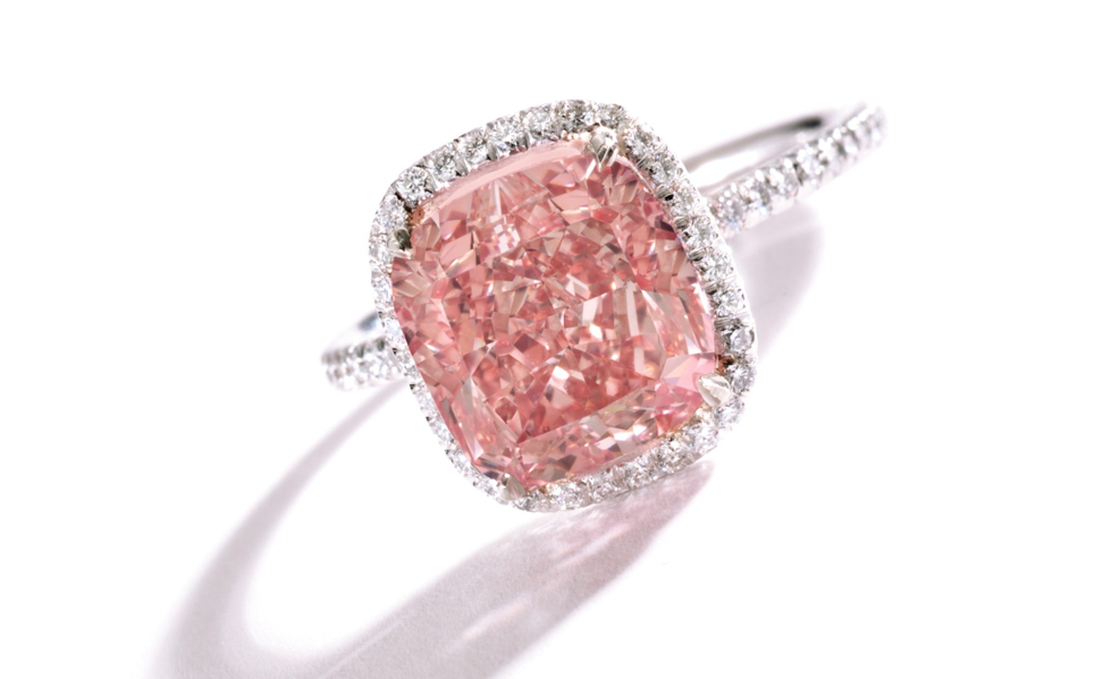 Lot 337 A Magnificent and Rare Fancy Vivid Pink Diamond Ring Est. $1.5/2 million. SOLD FOR $1,874,500