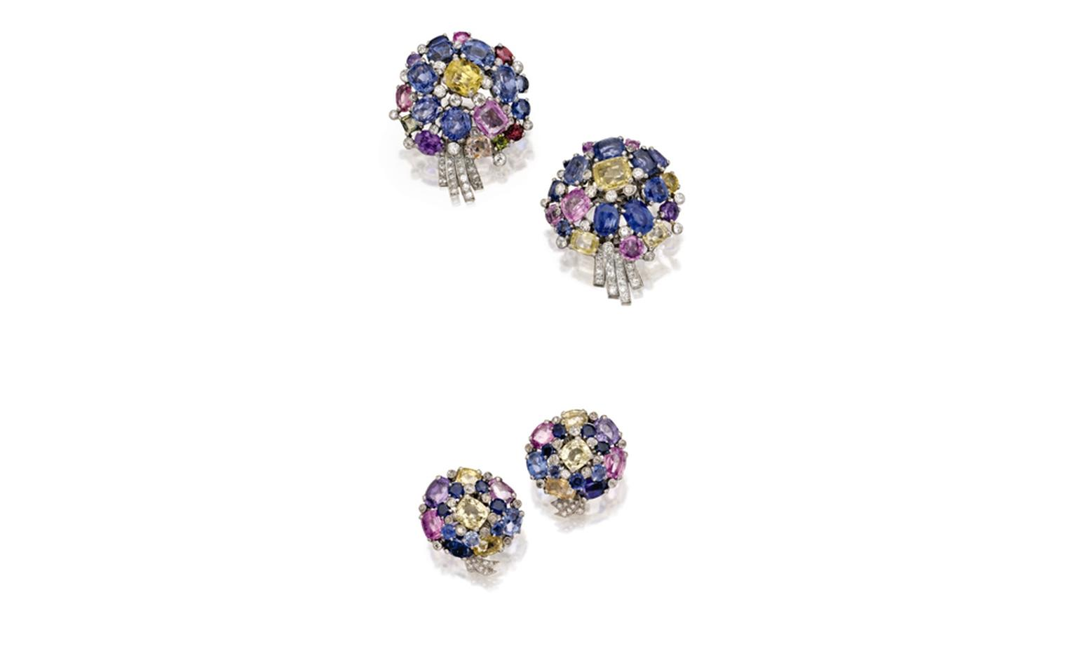Lot 369 Pair of Platinum, Multi-colored Sapphire and Diamond Flower Clip-Brooches, Cartier, London, Circa 1940 Est. $20/30,000 and Lot 370 Pair of Platinum, Multi-colored Sapphire and Diamond Flower Earclips, Cartier, London, Circa 1940 Est. $12...