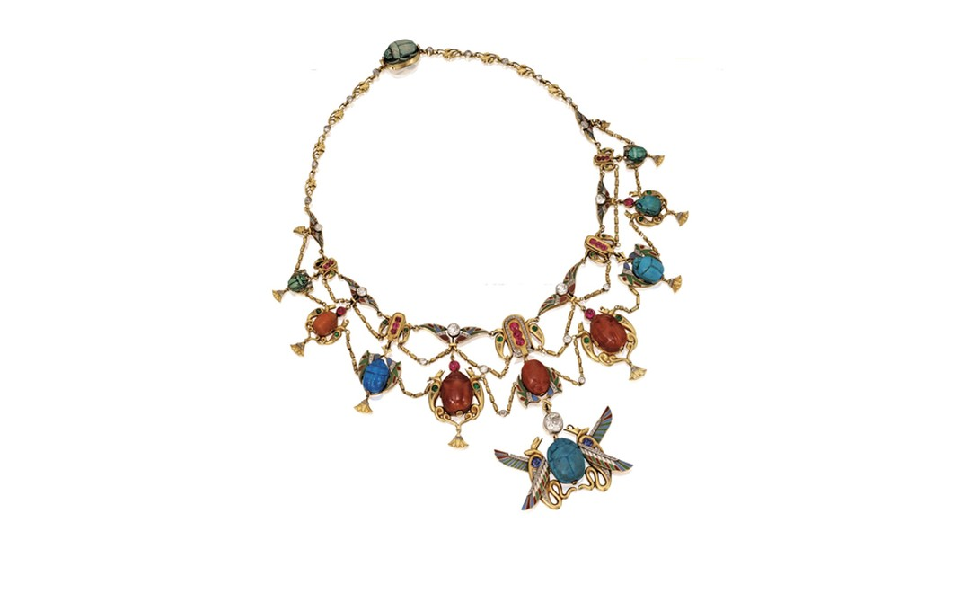 Lot 66 Gold, Platinum and Gem-Set Egyptian Revival Necklace and Pair of Bracelets, Early 20th Century Est. $40/60,000. SOLD FOR $50,000