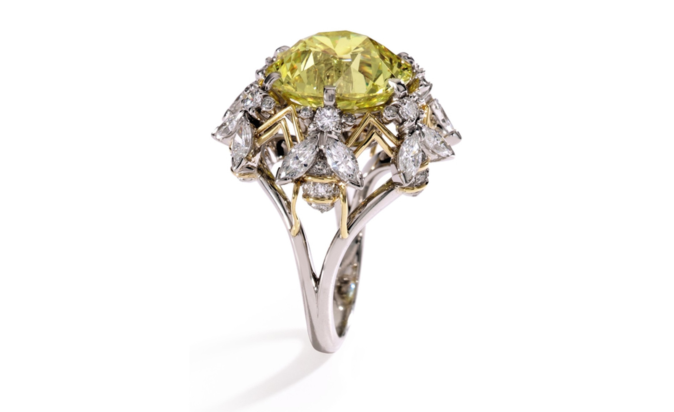 Lot 187 Platinum, 18 Karat Gold, Fancy Vivid Yellow Diamond and Near Colorless Diamond Ring, Schlumberger for Tiffany & Co., 1972 Est. $500/700,000. SOLD FOR $1,082,500