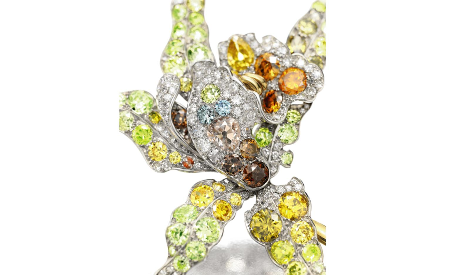 Lot 125, A COLORED DIAMOND FLOWER BROOCH. Christie's Images Ltd. 2010 Estimate $100,000 - 150,000 U.S. dollars.