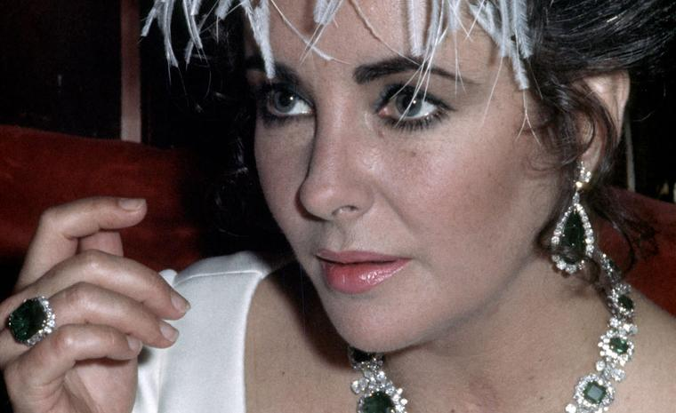 Elizabeth Taylor wearing Bulgari jewels. En tremblant brooch with diamonds and emeralds, an emeralds parure (gift of Richard Burton). Image courtesy of Bulgari. Credit, Getty Images.