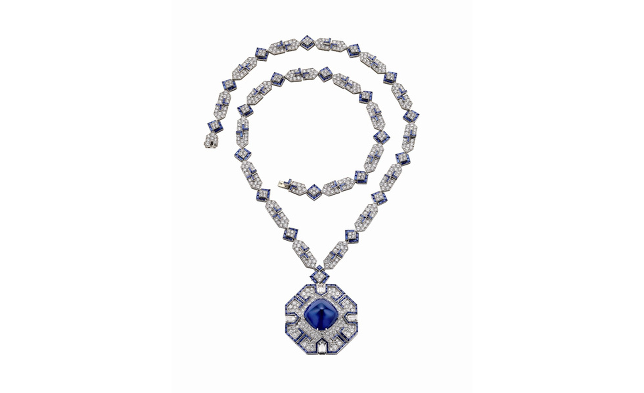 Bulgari sapphire and diamond necklace that belonged to Elizabeth Taylor. The sautoir is in platinum with sapphire and diamonds. The sugar-loaf cabochon sapphire of approximately 65 carats. The sautoir was given to Elizabeth Taylor by Richard Bur...