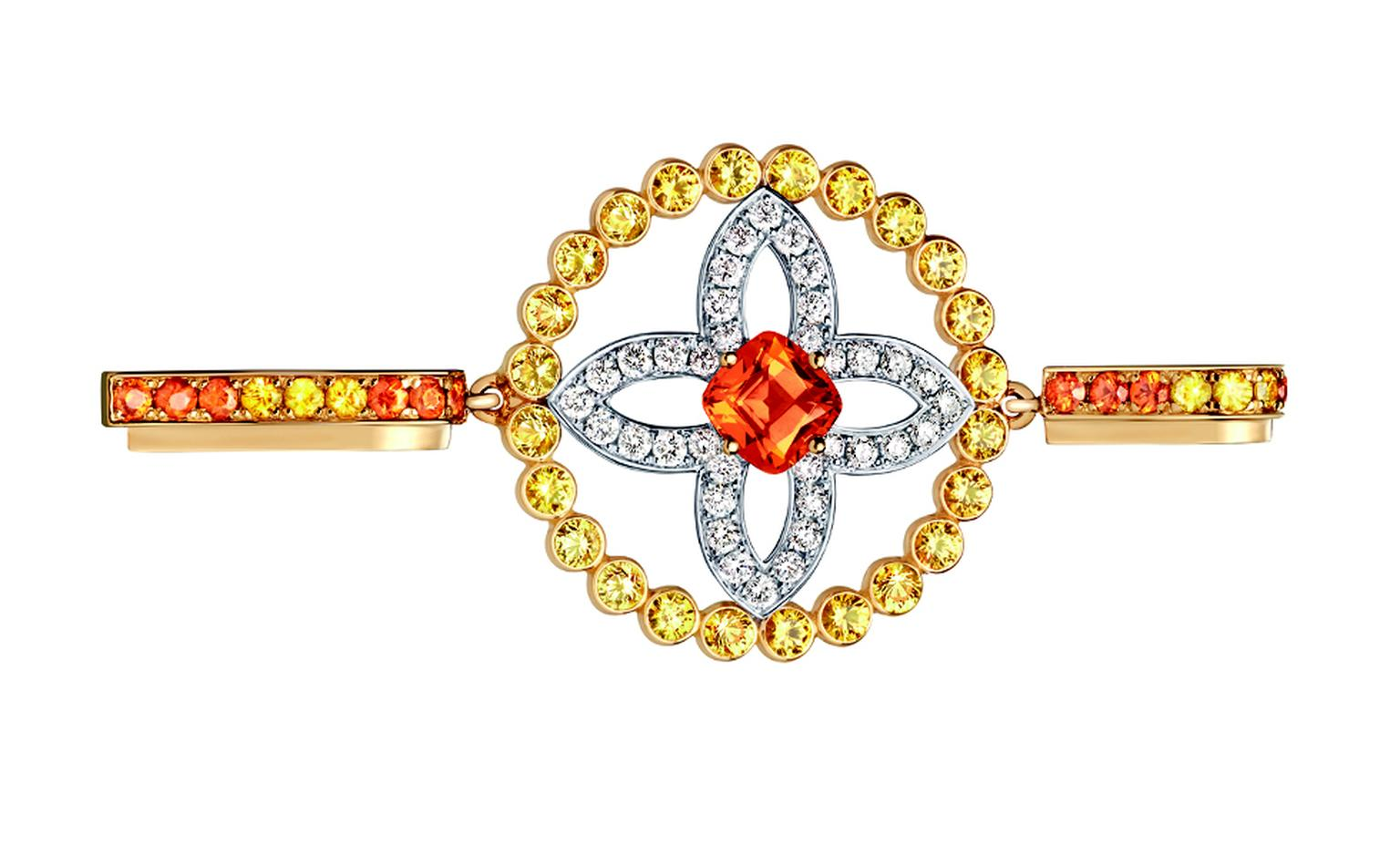 LOUIS VUITTON, Large Ornament Tribal Pendent, yellow gold, yellow sapphires, spessartite garnets and diamonds. £8,400
