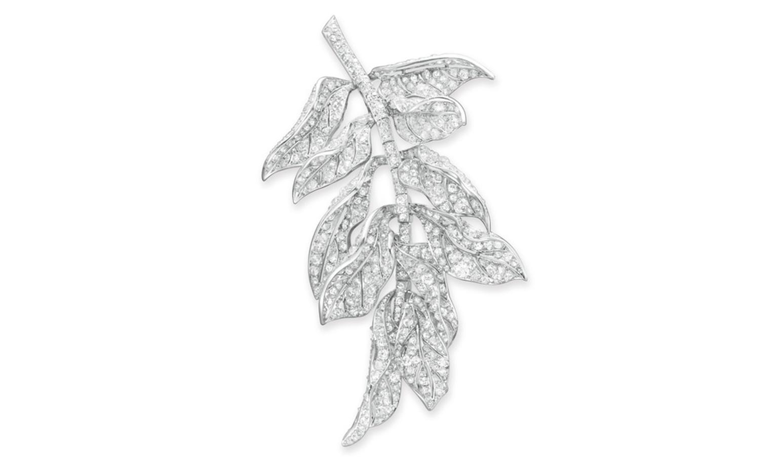 LOT 53 A DIAMOND AND PLATINUM BROOCH  Designed as an articulated cluster of old mine, old European and single-cut diamond scrolling leaves, to the single-cut diamond stem, mounted in platinum, circa 1940 Likely by Paul Flato Estimate $12,000-$18...