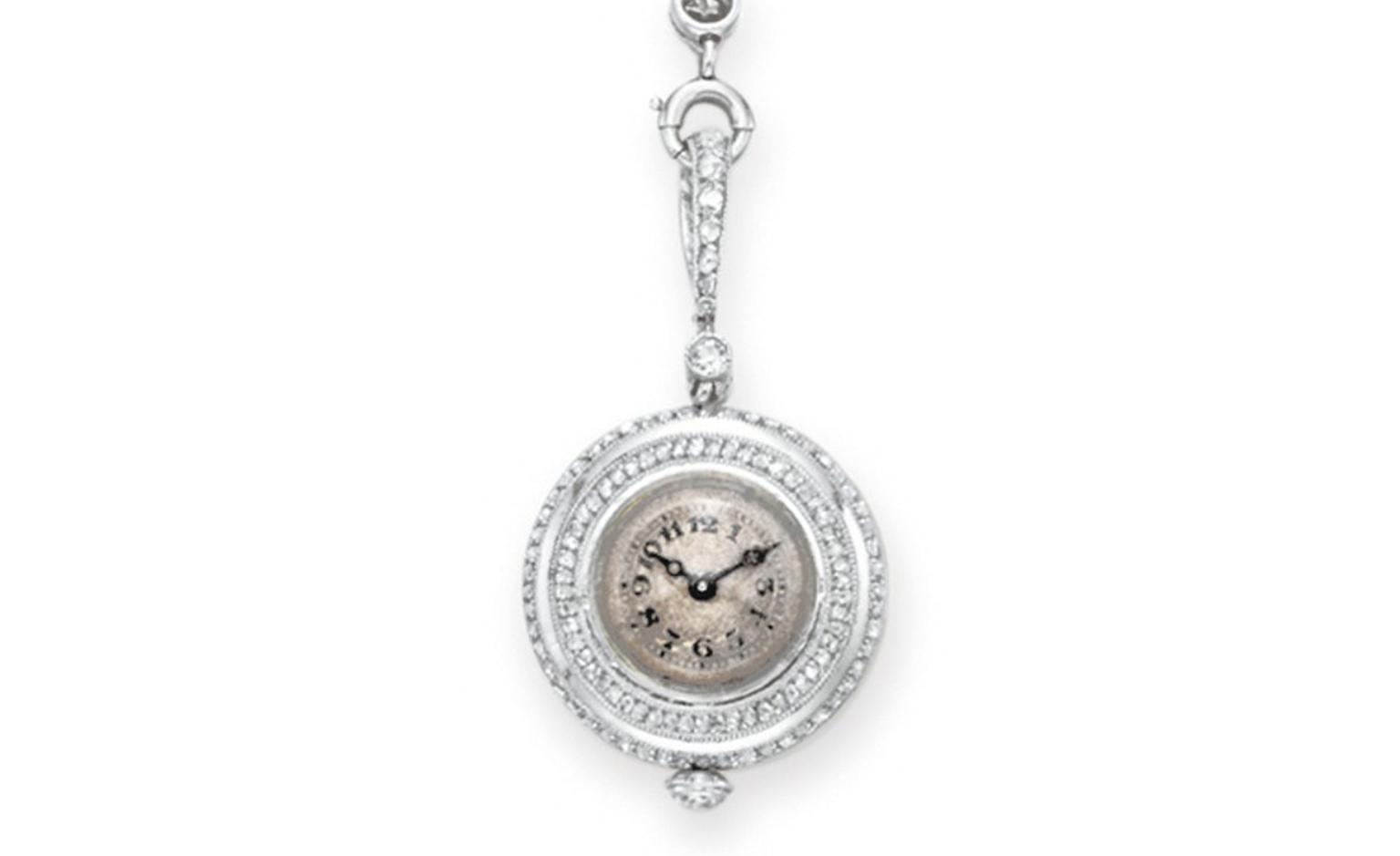 LOT 142 A BELLE EPOQUE PEARL AND DIAMOND PENDANT WATCH NECKLACE S circa 1910, 19 ins., with French assay marks Estimate $15,000-$20,000