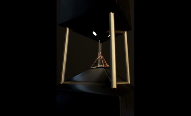 Hannah Martin's Comte Pyramid ring sitting on the obelisk designed by Mortiz Waldemeyer at its launch.