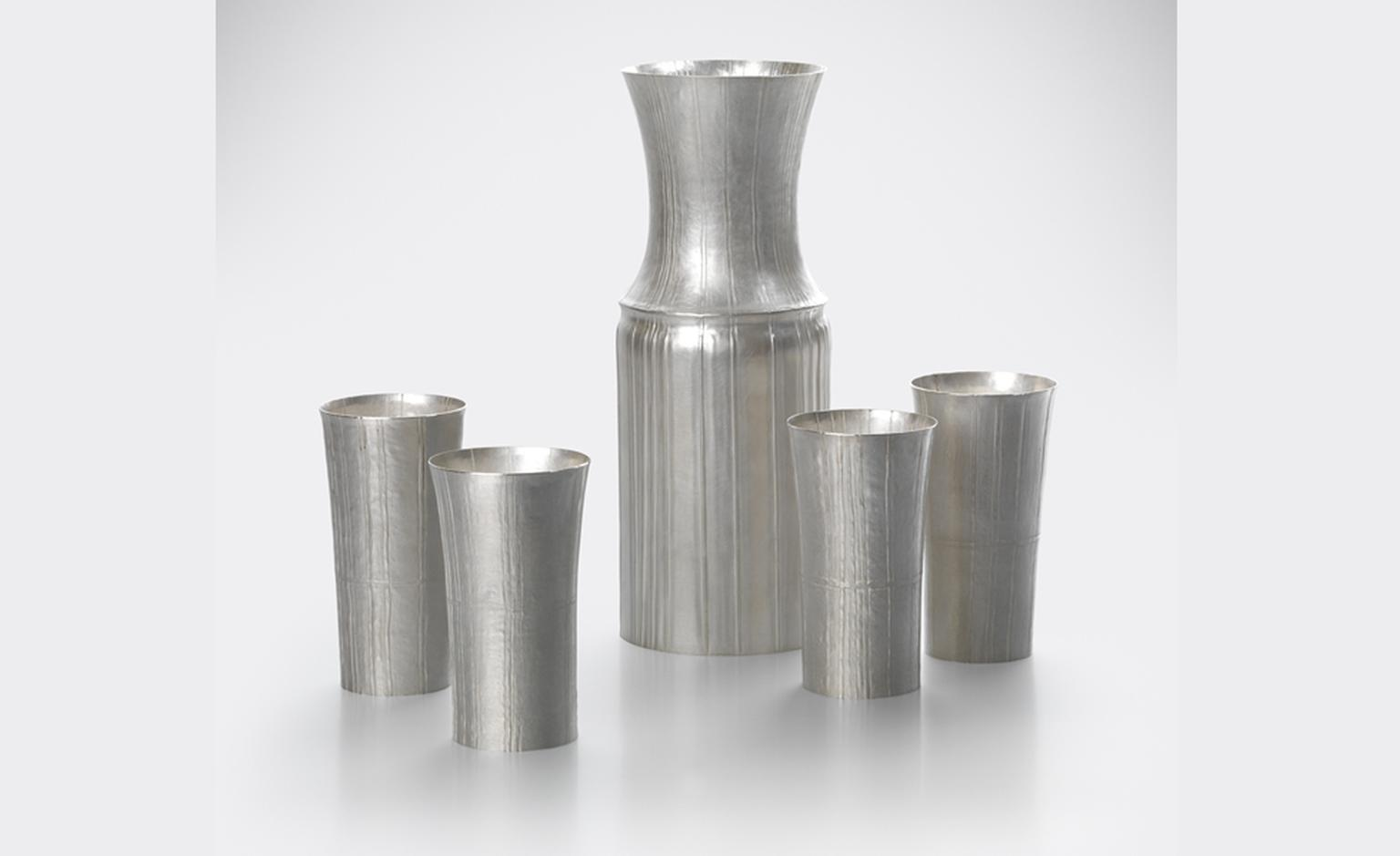 """Carafe and four Cups"". by Grant McCaig 2010 Pleated Fine Silver, seamed and hand raised."