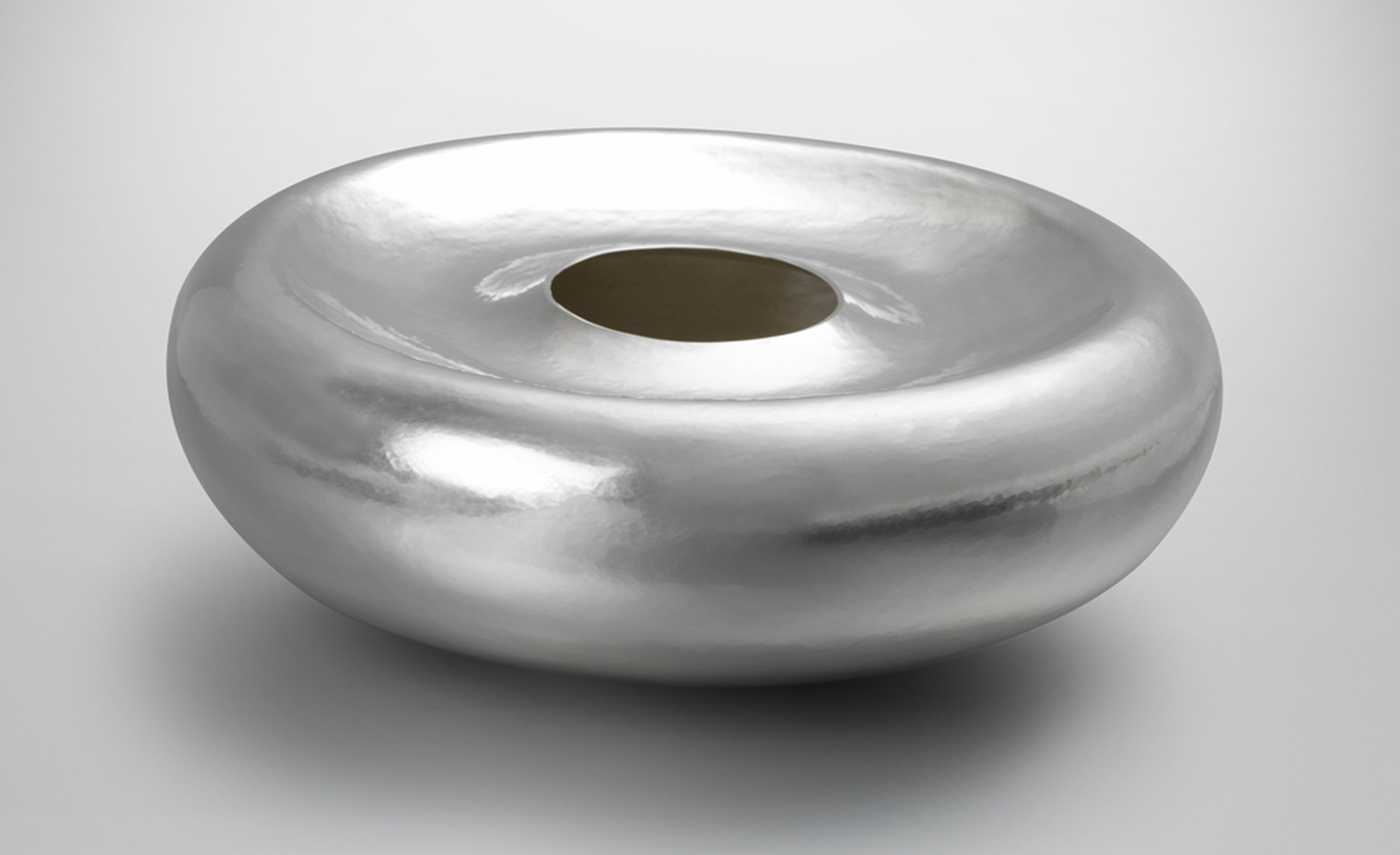 """Plunging Form"" by Sarah Denny, 2010 Hand-raised from a single flat sheet of Britannia silver."