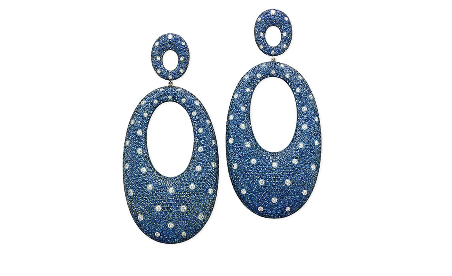 Lot 28. A pair of sapphire, diamond and titanium ear pendants. Each ear pendant designed as an oval titanium hoop mounted with pavé-set circular-shaped sapphires interspersed with brilliant-cut diamond collets of 'polka dot' motif suspended from...