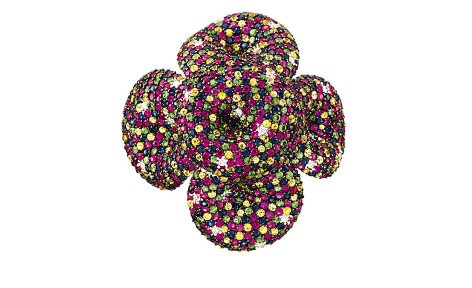 Lot 42. An unusual multi-gem cocktail ring. Designed as a moveable flowerhead, the centre and each undulating petal decorated with finely pavé-set coloured sapphires, diamonds, rubies and tsavorite garnets to the openwork gallery with plain hoop...