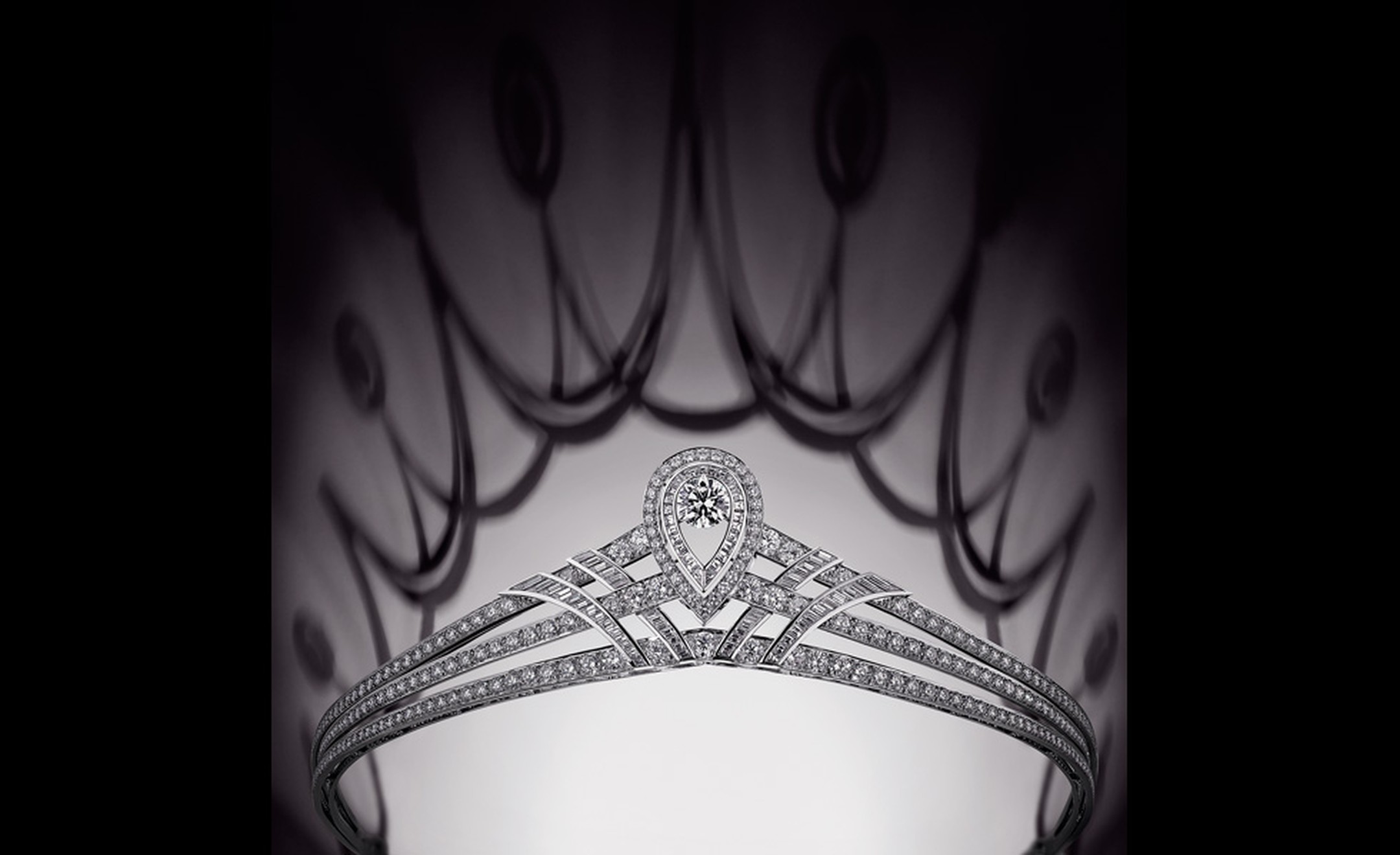 A Chaumet tiara for more formal occasions. Simple, clean lines highlight the central diamond that will shine light on the wearer like a halo.