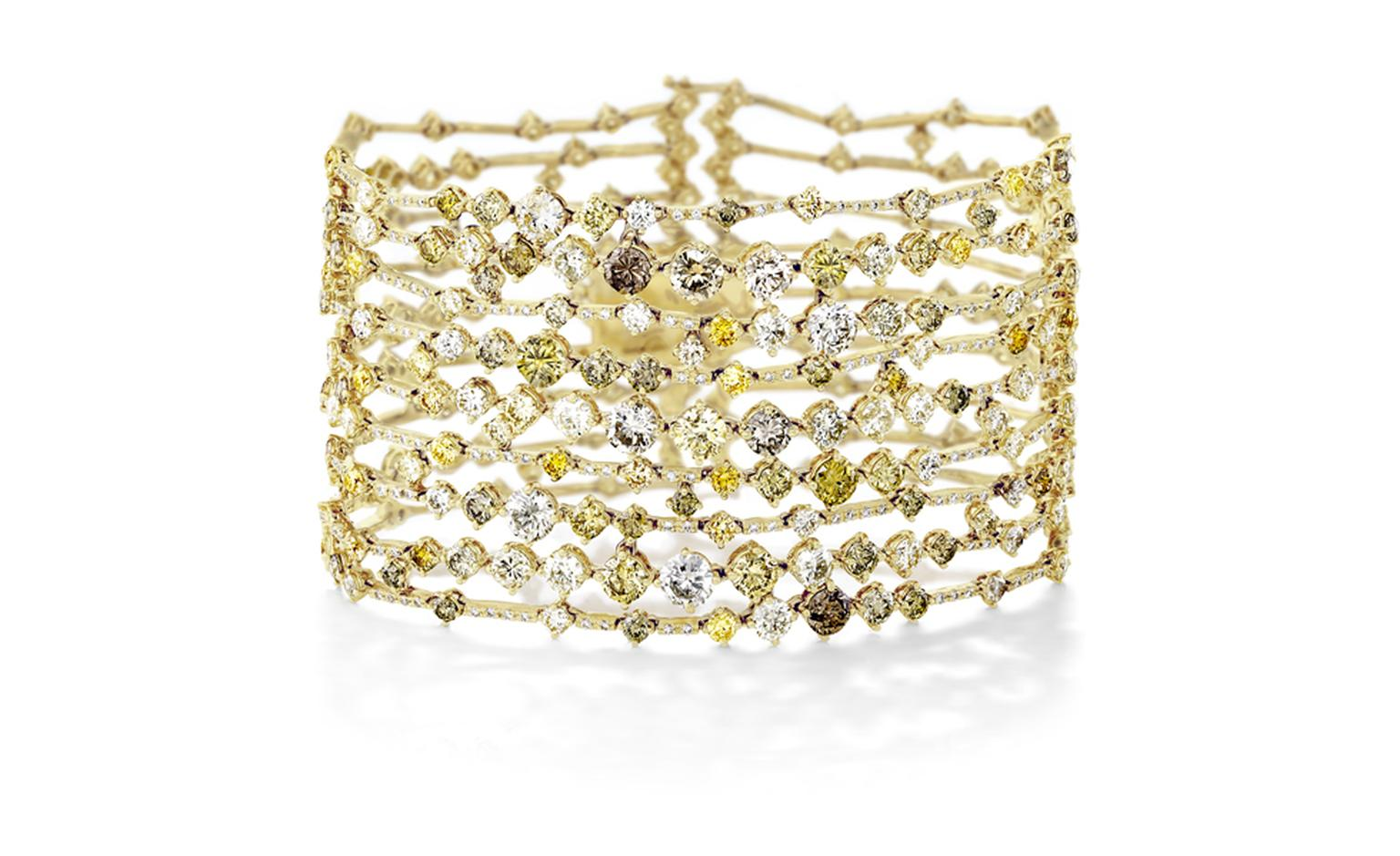 DE BEERS, Arpeggia collection, nine-lines bracelet in yellow gold. POA