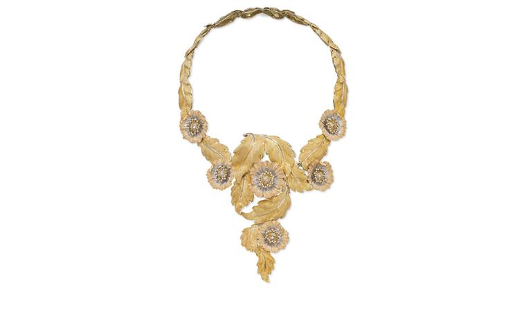 Lot 161. The 'Grand Collier Printemps', By Buccellati. Of V-shape design, with textured three colour gold leaves and flowerheads, each centering upon diamond-set pistils. Estimate  CHF 45,000 - CHF 55,000 SOLD FOR CHF 56,250