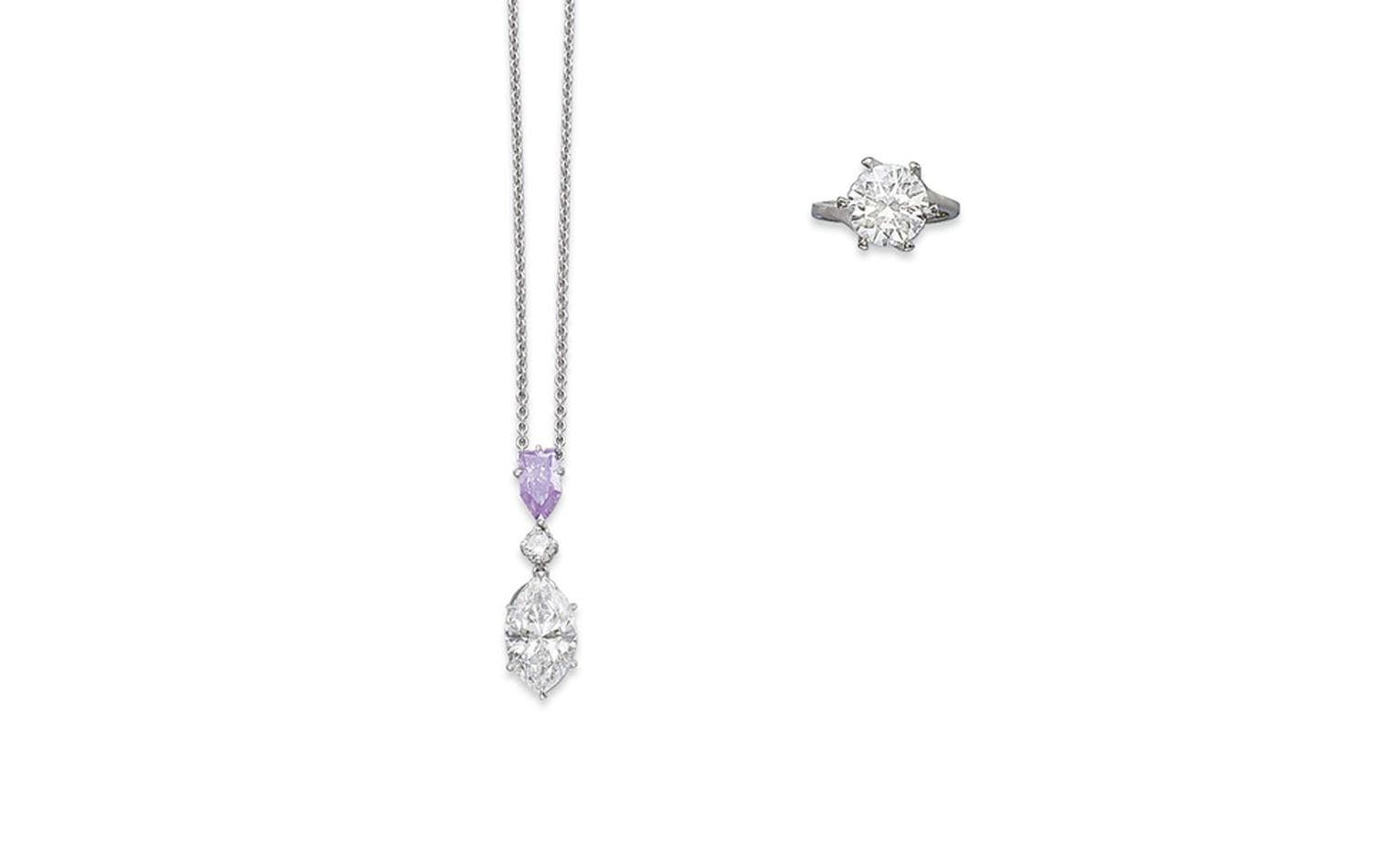 Lot 291. A coloured diamond pendant. The pendant set with a bullet-shaped fancy purple diamond, weighing 1.04 carat, suspending a brilliant-cut diamond and a marquise-cut diamond necklace. Estimate CHF 180,000 - CHF 220,000 SOLD FOR CHF 231,000