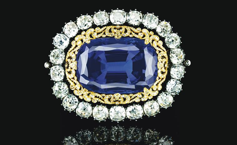 LLot 321. An Impressive sapphire and diamond brooch. Set with a cushion-cut sapphire, weighing 130.50 carats, to the openwork rose-cut diamond surround and collet-set old-cut diamond frame, mounted in silver and gold. Estimate CHF800, 000-CHF1,2...