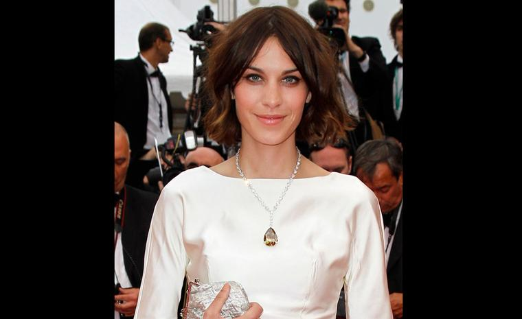 Alexa Chung wears an unusual 80.38 carat yellow-brown diamond pendant by Chopard on the red carpet at Cannes Film Festival 2011