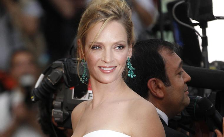 Uma Thurman in Chopard emerald chandelier earrings and bracelet at Cannes Film Festival 2011. The earrings sparkle with 34 pear-shaped emeralds.