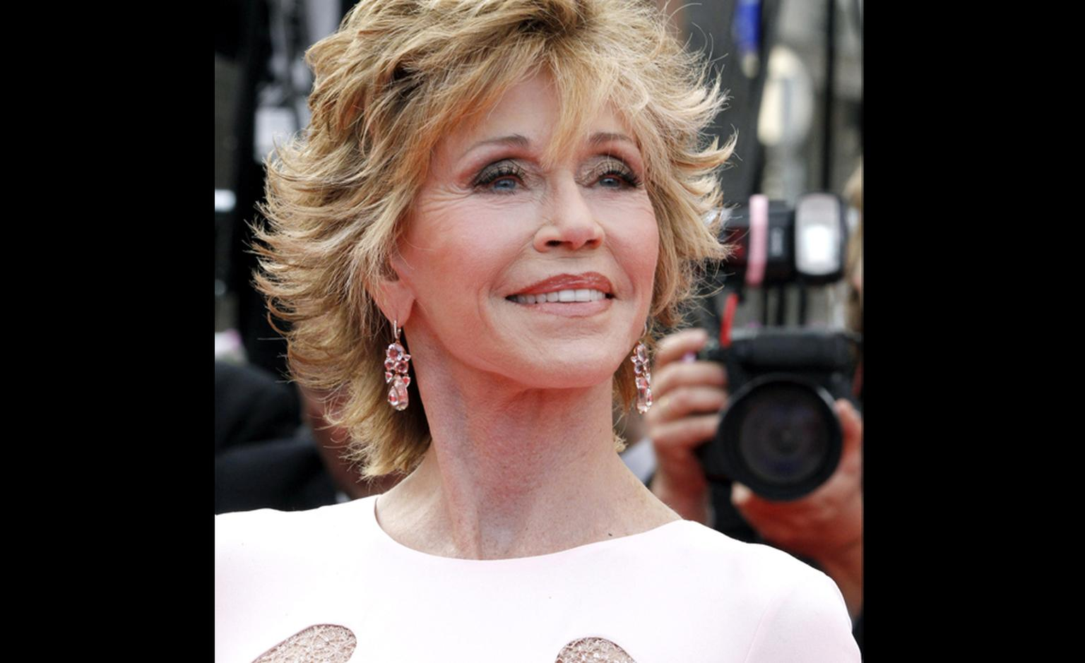 Jane Fonda wear Chopard tourmaline, spinel, morganite and diamond earrings on the red carpet at Cannes Film Festival 2011.