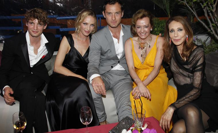 After the Trophée Chopard awards ceremony, the guests relax. From left to right, Trophée winnner Niels Schneider for his role in Heartbeats, Uma Thurman, Jude Law, Co-President of Chopard Caroline Gruosi-Scheufele and Marisa Berenson