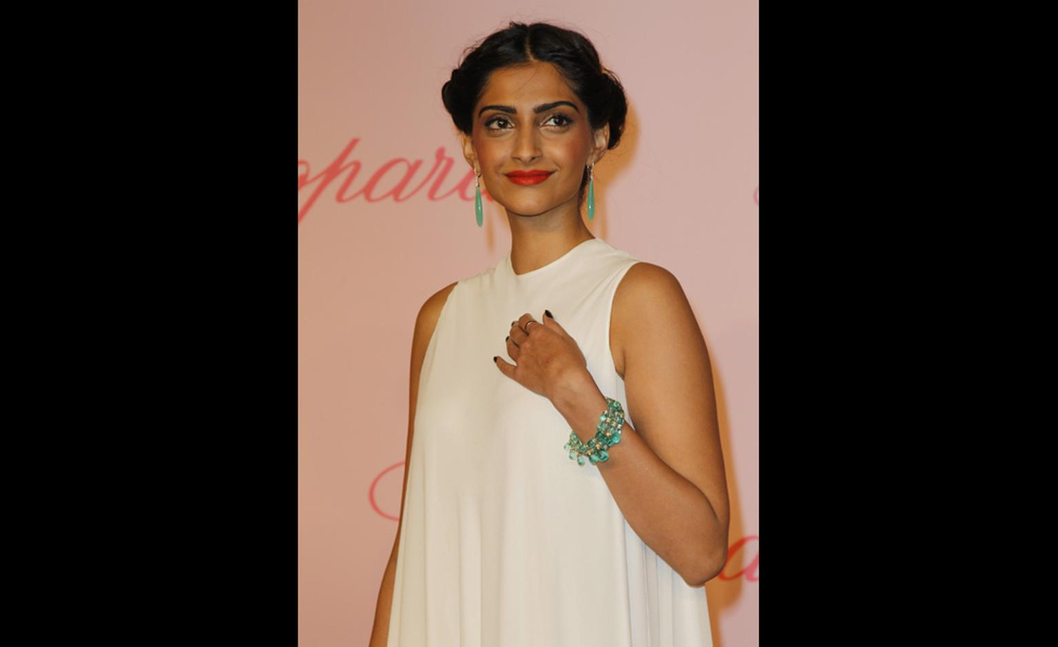 Sonam Kapoor at Chopard's Crazy Horse party at the Cannes Film Festival 2011 wearing Chopard jewels.